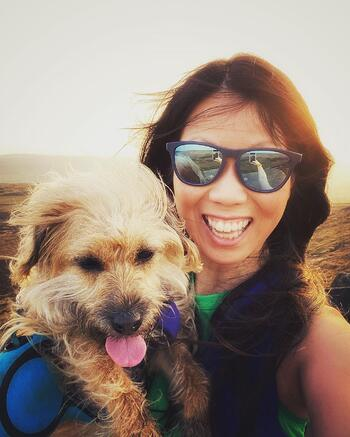 Partnerships Manager, Marie Cheng and her dog Millie on Higger Tor in the Peak District
