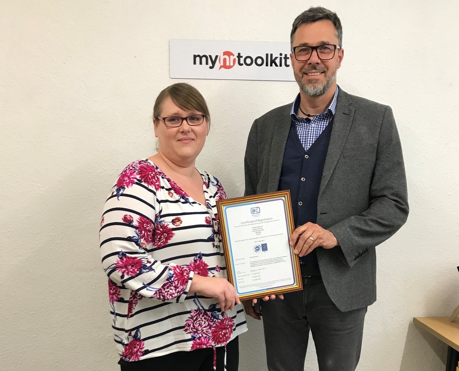 Amanda Grimstone and Jon Curtis with ISO 27001 certificate